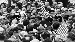 28th June 1963:  President John F Kennedy of the USA is almost lost among a crowd of well-wishers during his visit to Cork in Ireland.  (Photo by Keystone/Getty Images)