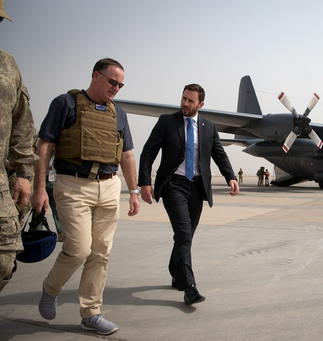 Spot the tourist. John Key is greeted at Baghdad airport by New Zealand ambassador to Iraq James Monroe (in suit). MIKE SCOTT/FAIRFAX NZ.